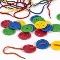 Botones con representación en Braille (140 piezas y 10 cordones)